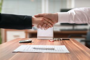 Businessman and lawyer shaking hands