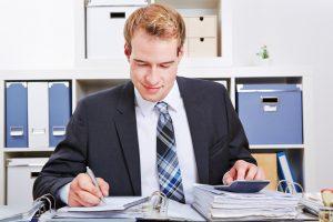 Businessman checking task audit report